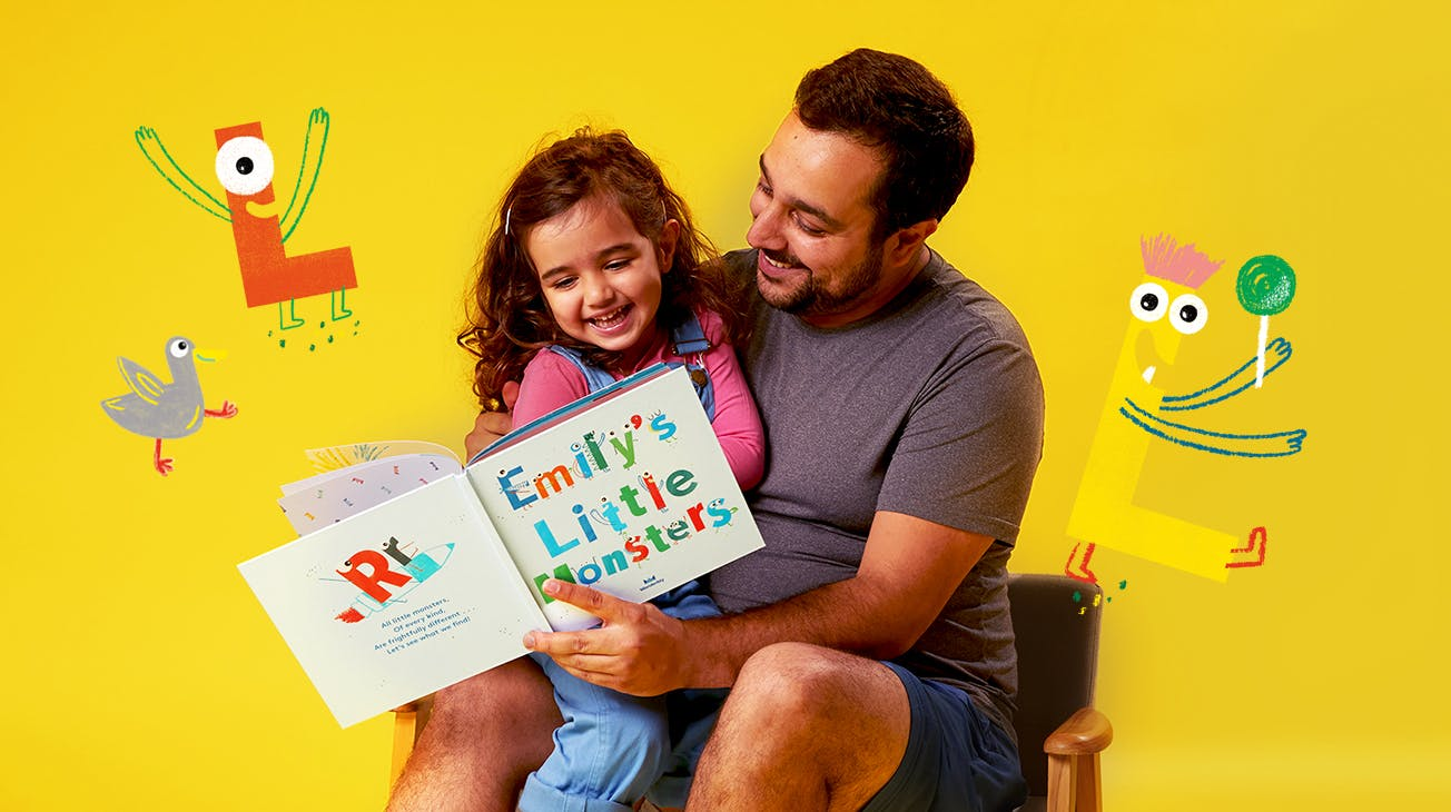 Father and Child reading My Little Monsters