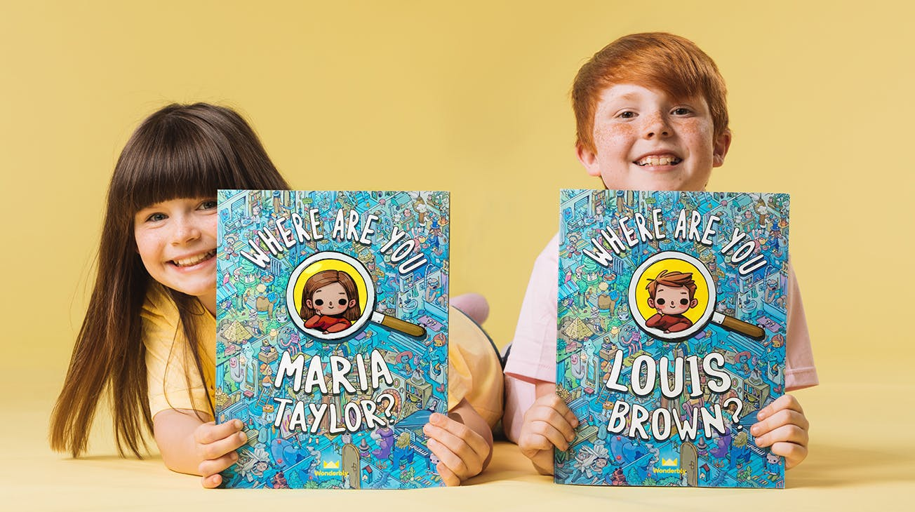 Two children holding their Where are you book